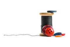 Thread bobbin and buttons Royalty Free Stock Photo