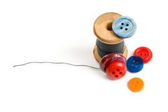 Thread bobbin and buttons Royalty Free Stock Photography