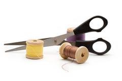 Thread bobbin and scissors Stock Photo