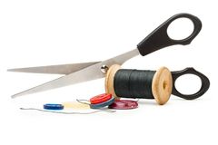 Thread bobbin, scissors and buttons Royalty Free Stock Photos
