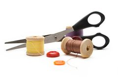 Thread bobbin, scissors and buttons Royalty Free Stock Images