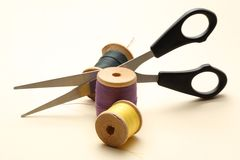 Thread bobbin and scissors Stock Photos