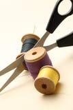 Thread bobbin and scissors Stock Photography