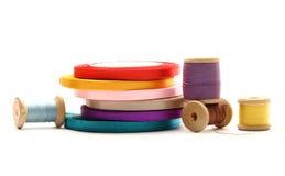 Thread bobbins and ribbon Royalty Free Stock Image