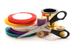 Thread bobbins, scissors and ribbon Stock Photography