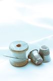 Thread bobbins and sewing thimbles Stock Photography