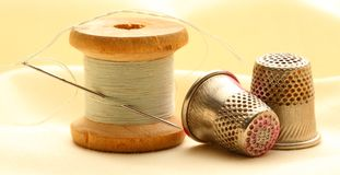 Thread bobbins and sewing thimbles Royalty Free Stock Photo