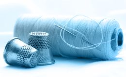 Thread bobbins and sewing thimbles Royalty Free Stock Photo