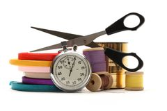 Thread bobbins, stopwatch, scissors Royalty Free Stock Photo