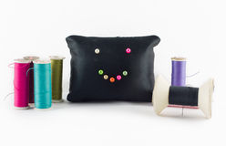 Thread color set with pillow black smile on white background. Royalty Free Stock Photo