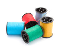 Thread coloured. Five bobbins colourful cotton thread Stock Photo