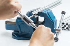 Thread cutting with a vise and taps Royalty Free Stock Image