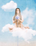 Thread of destiny. Angel with the thread of destiny sitting on the cloud royalty free stock photography