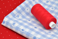 Thread on Floral Cloth Royalty Free Stock Image