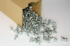Thread forming screws from box. A pile of self-tapping hex head screws Royalty Free Stock Image