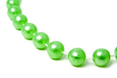 Thread with green beads Stock Photos
