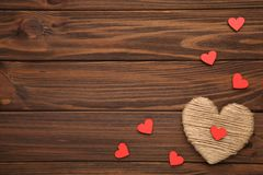 Thread heart on a wooden background royalty free stock photo