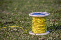 Thread of Kites. A beautiful spindles with yellow thread to fly kites Royalty Free Stock Images
