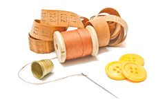 Thread, meter and yellow buttons Royalty Free Stock Photo