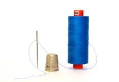 Thread with a needle. Blue thread with a needle Stock Photos