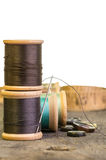 Thread and needle with buttons stock images