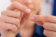 Thread into the needle. Stock Photography
