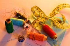 Thread the needle. The image thread and needles for sewing Atelier Royalty Free Stock Images