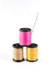 A Spool thread and needle Stock Photo