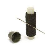 Thread, needle and thimble Stock Image