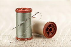 Thread and needle Royalty Free Stock Images