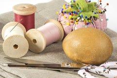 Thread, needles and darning egg Royalty Free Stock Image