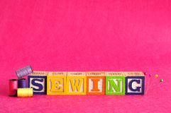Thread, pins and the word sewing Stock Photo