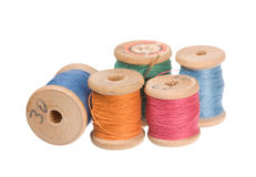 Thread reels. Vintage thread reels isolated on white Stock Photography