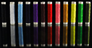 Thread reels. In rainbow colors royalty free stock photo