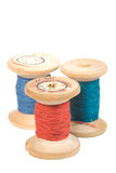 Thread reels. Vintage wooden reel of thread on white Royalty Free Stock Images