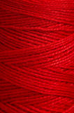 Thread roll. Red polyester thread roll or reel Royalty Free Stock Images