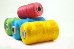 Thread rolls. Various color thread rolls in a row Royalty Free Stock Images