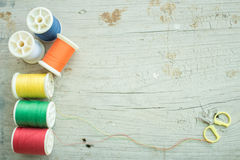 Thread and scissors. A colourful of thread and small scissors stock photography