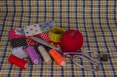 The thread, scissors and fabric Stock Photography