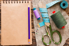 Thread, scissors, measuring tape and a notebook for notes Royalty Free Stock Image