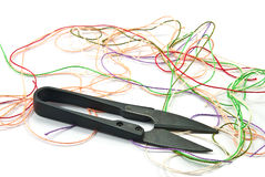 Thread and scissors. Multi-colored thread and scissors on white background stock images