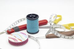 Thread, Scissors, Thread picker, Tracing wheel, and measuring ta stock images