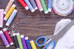 Thread and scissors Stock Images
