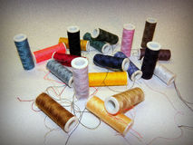 Thread for sewing. Sewing thread in different colors on a white shadowed basis Stock Image