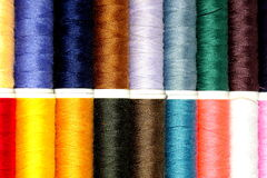 Thread for sewing. Sewing thread in different colors on a white shadowed basis Royalty Free Stock Photography