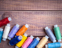 Thread and sewing. On wooden boards stock photos