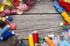 Thread and sewing. On wooden boards royalty free stock photos