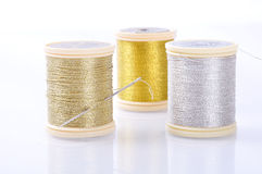 Thread, silk, gold, silver Stock Images