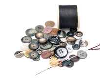 Thread spindles, buttons and needle Stock Image