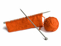 Thread and a spoke for knitting. Oranges thread and a spoke for knitting Royalty Free Stock Photography